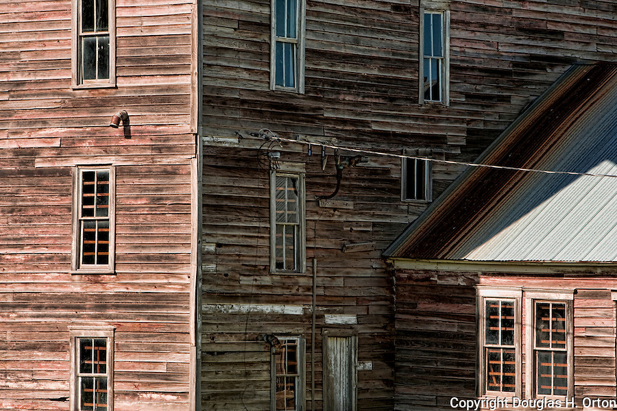 Historic flour mill stands in Oaksdale along the Palouse Scenic Byway in Washington State's Palouse Hills, the breakbasket of wheatfarming and a wonderfully scenic farming area of rolling  hills.  Palouse Country.  Eastern Washington