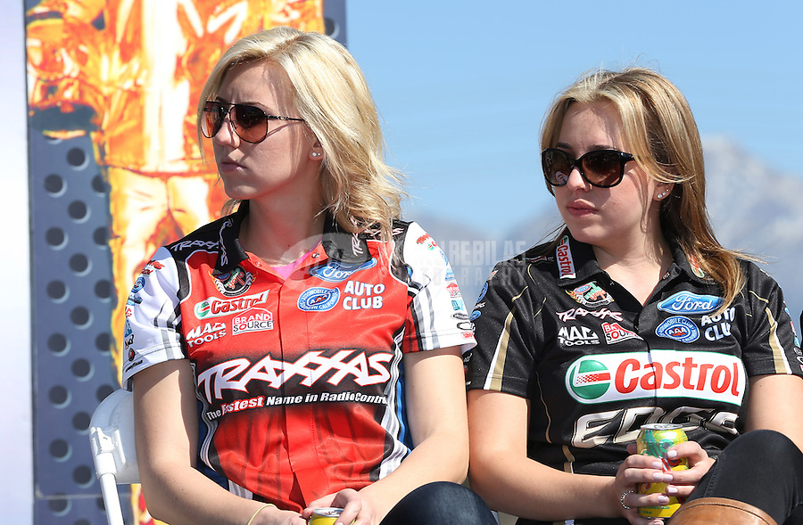 Feb. 14, 2013; Pomona, CA, USA; NHRA funny car driver Courtney Force (left) sits with her sister top fuel driver Brittany Force during qualifying for the Winternationals at Auto Club Raceway at Pomona.. Mandatory Credit: Mark J. Rebilas-