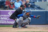 South Bend Cubs catcher Miguel Amaya (9) sets a target as home plate umpire Lance Seilhamer looks on during the game against the West Michigan Whitecaps at Fifth Third Ballpark on June 10, 2018 in Comstock Park, Michigan. The Cubs defeated the Whitecaps 5-4.  (Brian Westerholt/Four Seam Images)