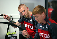 (L-R) Oliver McBurnie and Jay Fulton exercise in the gym during the Swansea City Training at The Fairwood Training Ground, Swansea, Wales, UK. Wednesday 01 November 2017