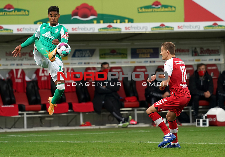 17.10.2020, Schwarzwald Stadion, Freiburg, GER, 1.FBL, SC Freiburg vs SV Werder Bremen<br /> <br /> im Bild / picture shows<br /> Theodor Gebre Selassie (Bremen), Nils Petersen (Freiburg)<br /> <br /> Foto © nordphoto / Bratic<br /> <br /> DFL REGULATIONS PROHIBIT ANY USE OF PHOTOGRAPHS AS IMAGE SEQUENCES AND/OR QUASI-VIDEO.