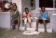25 June 1975, Lourencio Marques (now Maputo), Mozambique. Children on the street sell papers commemorating Mozambique's independence day.