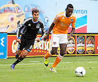 San Francisco, California - Saturday March 17, 2012: Je-Vaughn Watson dribbles the ball away from Chris Wondolowski during the MLS match at AT&T Park. . Houston Dynamo defeated San Jose Earthquakes  1-0