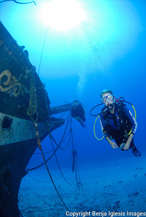 Diver swimming close to the bow of the carthaginian wreck of the west shore of Maui, Hawaii.