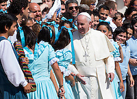 Papa Francesco saluta un gruppo di danzatrici la sua centesima udienza generale del mercoledi' in Piazza San Pietro, Citta' del Vaticano, 26 agosto 2015.<br /> Pope Francis greets a group of dancers at the end of his hundredth weekly general audience in St. Peter's Square at the Vatican, 26 August 2015.<br /> UPDATE IMAGES PRESS/Riccardo De Luca<br /> <br /> STRICTLY ONLY FOR EDITORIAL USE