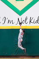 Roberto Lopez (20) of the Arkansas Travelers jumps for a hard hit ball to right field during a game against the Springfield Cardinals on May 10, 2011 at Hammons Field in Springfield, Missouri.  Photo By David Welker/Four Seam Images.