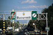 Bucharest, Romania. Main road with traffic leading into the city; end of motorway sign.