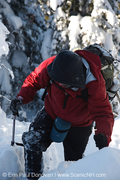 A winter hiker ascending the Carter - Moriah Trail on his way to Mount Moriah during the winter months in the White Mountains, New Hampshire USA