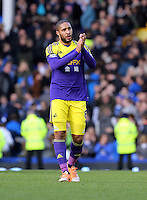 Pictured: Ashley WIlliams of Swansea thanks away supporters. Sunday 16 February 2014<br /> Re: FA Cup, Everton v Swansea City FC at Goodison Park, Liverpool, UK.