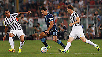 Calcio, Supercoppa di Lega: Juventus vs Lazio. Roma, stadio Olimpico, 18 agosto 2013<br /> Lazio midfielder Hernanes, of Brazil, center, is challenged by Juventus midfielder Arturo Vidal, of Chile, left, and defender Stephan Lichsteiner, of Switzerland, during the Italian League Supercup football final match between Juventus and Lazio, at Rome's Olympic stadium,  18 August 2013.<br /> UPDATE IMAGES PRESS/Riccardo De Luca