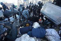Policemen arrest some protesters  during the forced eviction of Maidan square.  Kiev, Ukraine