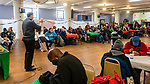 WATERBURY, CT. 21 December 2019-122119BS296 - Father James Sullivan blesses everyone attending for a Christmas Party for the less fortunate and homeless in the basement of the Basilica of Immaculate Conception in Waterbury on Saturday. Bill Shettle Republican-American