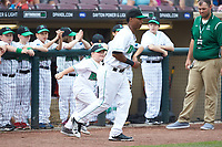 A young fan takes the field with Dayton Dragons second baseman Dayton Dragons prior to the game against the Bowling Green Hot Rods at Fifth Third Field on June 9, 2018 in Dayton, Ohio. The Hot Rods defeated the Dragons 1-0.  (Brian Westerholt/Four Seam Images)