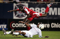 Chicago's Damani Ralph, top and New England's John Avery, bottom, collide during the second half of a 1-1 tie at Soldier Field, in Chicago, IL, Sunday July 11, 2004.