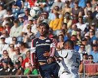New England Revolution midfielder Juan Carlos Toja (7) and LA Galaxy defender Sean Franklin (5) battle for head ball.  In a Major League Soccer (MLS) match, the New England Revolution (blue) defeated LA Galaxy (white), 5-0, at Gillette Stadium on June 2, 2013.