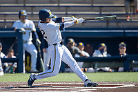 Michigan Wolverines outfielder Tito Flores (22) swings the bat during the NCAA baseball game against the Illinois Fighting Illini on March 20, 2021 at Fisher Stadium in Ann Arbor, Michigan. Michigan won the game 8-1. (Andrew Woolley/Four Seam Images)