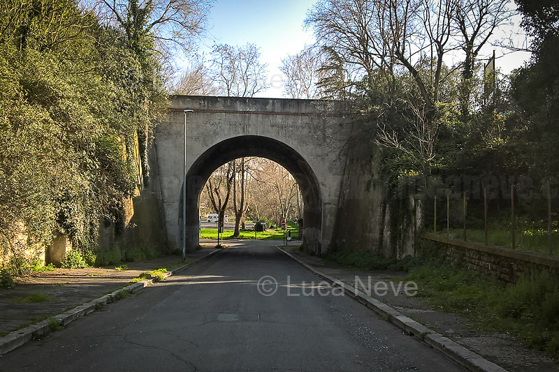 Rome, 15/03/2020. Rome's Olympic Village district under the Italian Government lockdown for the Outbreak of the Coronavirus SARS-CoV-2 - COVID-19. On the 22nd March, the Italian PM Giuseppe Conte signed a new Decree Law which suspends non-essential industry productions and contains the list of allowed working activities, which includes Pharmaceutical & food Industry, oil & gas extraction, clothes & fabric, tobacco, transports, postal & banking services (timetables & number of agencies reduced), delivery, security, hotels, communication & info services, architecture & engineer, IT manufacturers & shops, call centers, domestic personnel (1.).<br /> Updates: Italy: 22.03.20, 6:00PM: 46.638 positive cases; 7.024 recovered; 5.476 died.<br /> <br /> The Rome's Olympic Village (1957-1960) was designed by: V. Cafiero, A. Libera, A. Luccichenti, V. Monaco, L. Moretti. «Built to host the approximately 8,000 athletes involved in the 1960 Olympic Games, Rome's Olympic Village is a residential complex located between Via Flaminia, the slopes of Villa Glori and Monti Parioli. It was converted into public housing [6500 inhabitants, ndr] at the end of the sporting event. The intervention is an example of organic settlement, characterized by a strong formal homogeneity, consistent with the Modern Movement's principles of urbanism. The different architectural structures are made uniform by the use of some common elements: the pilotis, ribbon windows, concrete stringcourses, and yellow brick curtain covering. At the center of the neighborhood, the Corso Francia viaduct - a road bridge about one kilometer long - was built by Pier Luigi Nervi […]» (2.).<br /> <br /> Info about COVID-19 in Italy: http://bit.do/fzRVu (ITA) - http://bit.do/fzRV5 (ENG)<br /> 1. March 22nd Decree Law http://bit.do/fFwJn (ITA)<br /> 2. (Atlantearchitetture.beniculturali.it MiBACT, ITA - ENG) http://bit.do/fFw3H<br /> 12.03.20 Rome's Lockdown for the Outbreak of the Coronavirus SARS-CoV-2 - COVID-19 http://bit