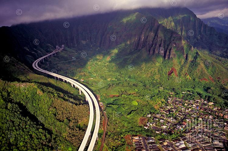 Aerial of the H3 highway, the Koolau Mountains, and a Kaneohe neighborhood