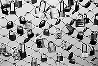 Austria. Salzburg. Love locks sealed along the Markartsteg bridge above Sazach river. A love lock or love padlock is a padlock which sweethearts lock to a bridge, fence, gate, or similar public fixture to symbolize their love. Typically the sweethearts' names or initials are inscribed on the padlock, and its key is thrown away to symbolise unbreakable love. Since the 2000s, love locks have proliferated at an increasing number of locations worldwide. They are often treated by municipal authorities as litter or vandalism, and there is some cost to their removal. Salzburg is the fourth-largest city in Austria and the capital of the federal state of Salzburg. 9.04.2014 © 2014 Didier Ruef