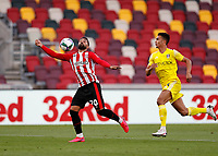 1st October 2020; Brentford Community Stadium, London, England; English Football League Cup, Carabao Cup Football, Brentford FC versus Fulham; Saman Ghoddos of Brentford chests down the ball with Antonee Robinson of Fulham marking