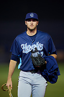 Corpus Christi Hooks pitcher Ryan Thompson (27) walks back to the dugout after a game against the Tulsa Drillers on June 3, 2017 at ONEOK Field in Tulsa, Oklahoma.  Corpus Christi defeated Tulsa 5-3.  (Mike Janes/Four Seam Images)