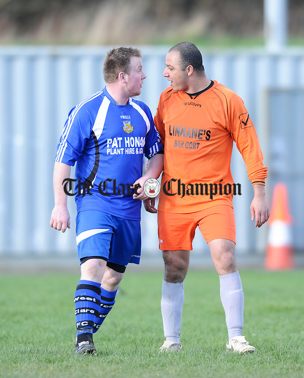 Damien Honan of West Clare FC exchanges views with Daniel Panto of Coole FC during their Cup game at Kilrush. Photograph by John Kelly.