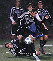 Carlsbad High School playing Rancho Bernardo High School in the rain in 2010.  photo for North County Times