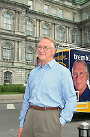 """Montreal, June 19, 2001<br /> Leader of Union de l'""""le de Montreal (Montreal Island's Union) leader and candidate for Montreal Mayor ;<br /> Gerald Tremblay show his tour bus to the media, in front of Montreal City Hall, june 19, 2001.<br /> Tremblay hopes to defeat Montreal actual Mayor Pierre Bourque"""