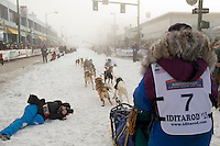 Michelle Phillips leaves the start line on 4th avenue in the fog during the ceremonial start of the Iditarod sled dog race in downtown Anchorage Saturday, March 2, 2013. ..Photo (C) Jeff Schultz/IditarodPhotos.com  Do not reproduce without permission