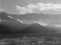 """""""Low Clouds in Death Valley"""" <br /> Death Valley National Park, California<br /> <br /> The most dominant feature of Death Valley National Park for me is the tremendous amount of sunlight that floods the valley floor. The photo shown here was an attempt to convey this feature where the surrounding foothills touch the valley floor."""