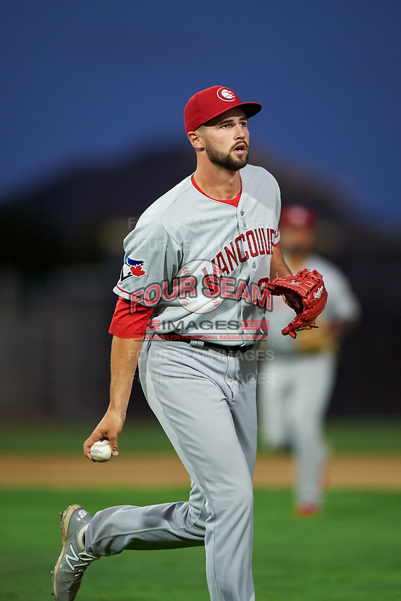 Vancouver Canadians starting pitcher Adam Kloffenstein (34) flips the ball to the first baseman during a Northwest League game against the Tri-City Dust Devils at Gesa Stadium on August 21, 2019 in Pasco, Washington. Vancouver defeated Tri-City 1-0. (Zachary Lucy/Four Seam Images)