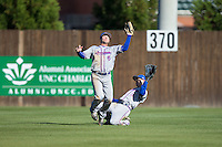 Louisiana Tech Bulldogs left fielder J.D. Perry (6) cuts in front of center fielder Bryce Stark (8) to make a catch against the Charlotte 49ers at Hayes Stadium on March 28, 2015 in Charlotte, North Carolina.  The 49ers defeated the Bulldogs 9-5 in game two of a double header.  (Brian Westerholt/Four Seam Images)