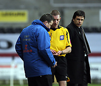 Pictured: Match referee Steve Tanner (C) hands over the items that were thrown to a Coventry City player to stadium security (L) under the watchful eye of Coventry manager Chris Coleman (R).<br /> Re: Coca Cola Championship, Swansea City FC v Coventry City at the Liberty Stadium. Swansea, south Wales, Friday 26 December 2008.<br /> Picture by D Legakis Photography / Athena Picture Agency, Swansea 07815441513