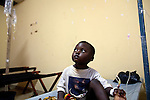 Four-year-old Saidouba Sylla sits up shortly after receiving an IV infusion at Donka Cholera Treatment Center in Conakry, Guinea, Aug. 16, 2012. Saidouba's father Fode Sylla said it took the family two and a half hours to travel through Conakry's congested streets to the treatment center, a delay which caused Saidouba to become extremely dehydrated from the effects of cholera. Médecins Sans Frontières is responding to a cholera outbreak in Guinea, which is affecting coastal areas and inland. Two emergency MSF cholera treatment centers in Conakry are receiving around 60 new cases per day, and a third treatment center opened over the weekend.