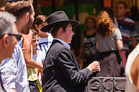 Israel,Jerusalem, a young orhodox jude boy smile in the Mahane Yehuda Open Air Food Market, in the Shabbat day