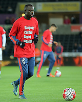 """Modou Barrow of Swansea warms up wearing a """"Show Racism the Red Card"""" shirt before the Barclays Premier League match between Swansea City and Stoke City played at the Liberty Stadium, Swansea on October 19th 2015"""