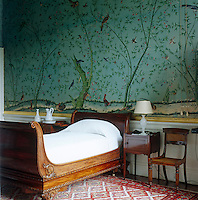 The Wellington Dressing Room is furnished with a Regency lit bateau and features Chinese wallpaper which dates from 1830