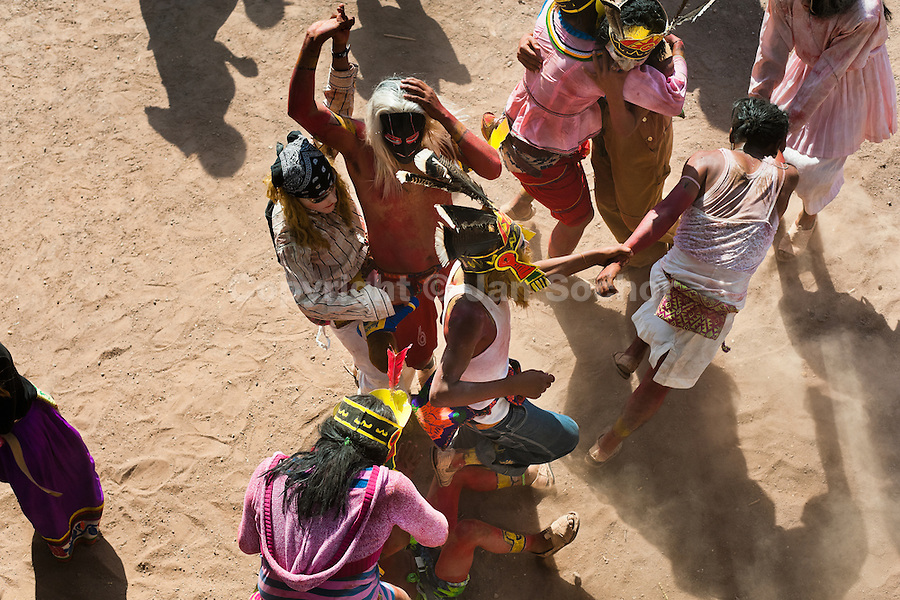 """Cora Indians, wearing colorful masks, dance during the religious ritual ceremony of Semana Santa (Holy Week) in Jesús María, Nayarit, Mexico, 23 April 2011. The annual week-long Easter festivity (called """"La Judea""""), performed in the rugged mountain country of Sierra del Nayar, merges indigenous tradition (agricultural cycle and the regeneration of life worshipping) and animistic beliefs with the Christian dogma. Each year in the spring, the Cora villages are taken over by hundreds of wildly running men. Painted all over their semi-naked bodies, fighting ritual battles with wooden swords and dancing crazily, they perform demons (the evil) that metaphorically chase Jesus Christ, kill him, but finally fail due to his resurrection. La Judea, the Holy Week sacred spectacle, represents the most truthful expression of the Coras' culture, religiosity and identity."""