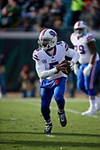 Buffalo Bills quarterback Tyrod Taylor (5) scrambles during an NFL Wild-Card football game against the Jacksonville Jaguars, Sunday, January 7, 2018, in Jacksonville, Fla.  (Mike Janes Photography)