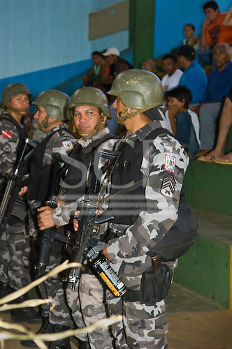 """Altamira, Brazil. """"Xingu Vivo Para Sempre"""" protest meeting about the proposed Belo Monte hydroeletric dam and other dams on the Xingu river and its tributaries. Riot police arrive at the Gymnasium, machine guns and gas canisters of teargas."""