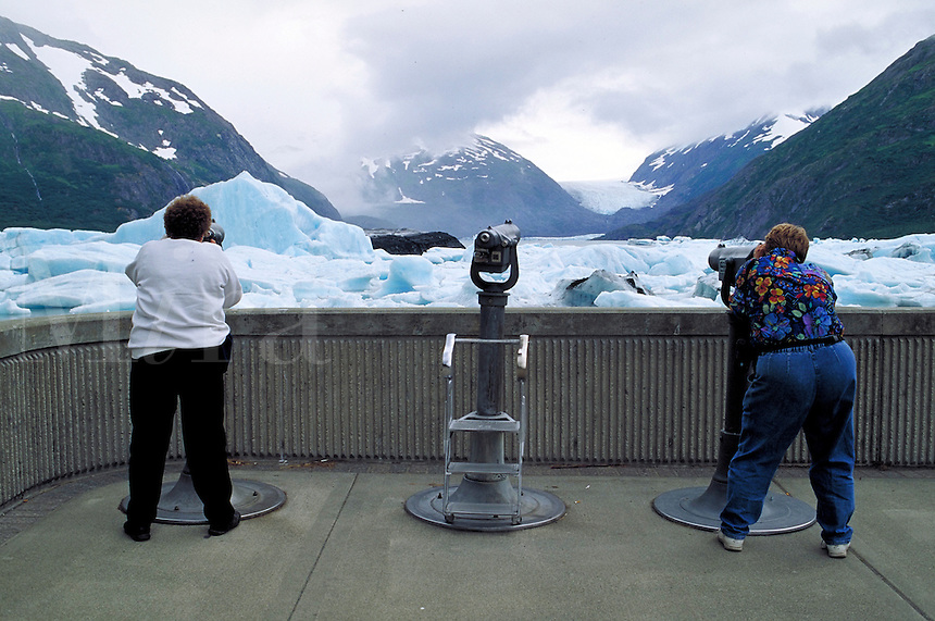 two tourists viewing glacial ice flow