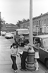 KIDS PLAYING IN THE STREET ELEPHANT AND CASTLE SOUTH LONDON 1970S