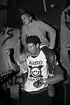 Frontline at Gilman Street. Grant McIntyre in Rabid Lassie t-shirt with mohawk kid on his shoulders.
