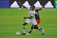 WASHINGTON, DC - NOVEMBER 8: Victor Wanyama #2 of Montreal Impact battles for the ball with Ola Kamara #9 of D.C. United during a game between Montreal Impact and D.C. United at Audi Field on November 8, 2020 in Washington, DC.