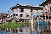 Myanmar, Burma.  Traditional House on Stilts, Inle Lake, Shan State.  Note blue satellite dish on left.
