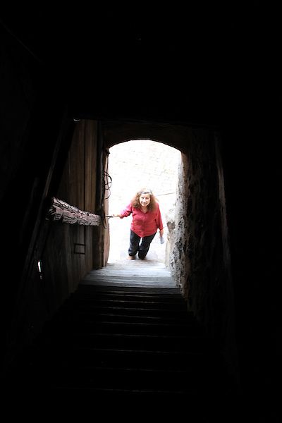 Beth ascending tower stairs in Turckheim, Alsace, France