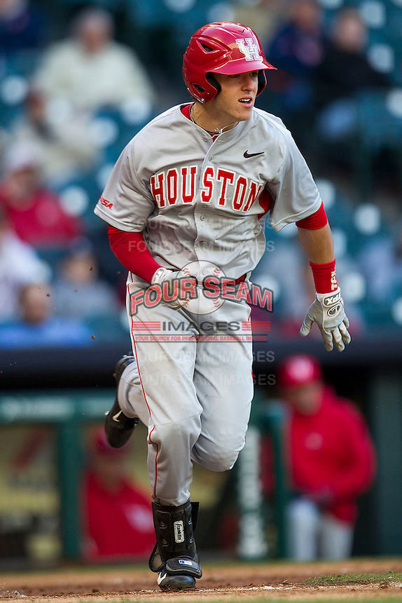 Houston Cougars outfielder Kyle Survance #34 runs to first base against the Baylor Bears in the NCAA baseball game on March 2, 2013 at Minute Maid Park in Houston, Texas. Houston defeated Baylor 15-4. (Andrew Woolley/Four Seam Images).