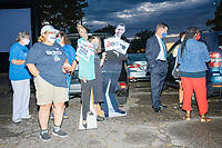 """People stand with cardboard cutouts of Barack Obama and Hillary Clinton as people gathered to watch the 2020 Democratic National Convention at a """"Ridin' with Biden"""" Drive-In Theater viewing event at Suffolk Downs in Boston, Massachusetts, on Wed., Aug. 19, 2020."""
