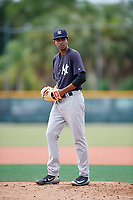 GCL Yankees East starting pitcher Yoendrys Gomez (15) gets ready to deliver a pitch during the first game of a doubleheader against the GCL Pirates on July 31, 2018 at Pirate City Complex in Bradenton, Florida.  GCL Yankees East defeated GCL Pirates 2-0.  (Mike Janes/Four Seam Images)