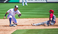 14 March 2014: Detroit Tigers second baseman Ian Kinsler makes a play to get a sliding Nate McLouth at second during a Spring Training Game against the Washington Nationals at Joker Marchant Stadium in Lakeland, Florida. The Tigers defeated the Nationals 12-6 in Grapefruit League play. Mandatory Credit: Ed Wolfstein Photo *** RAW (NEF) Image File Available ***